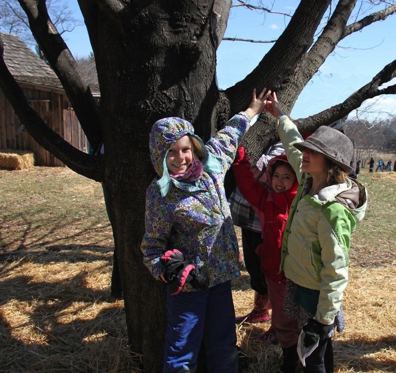 Girls+Smiling+at+Tree