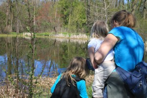mom-with-daughters-looking-at-pond